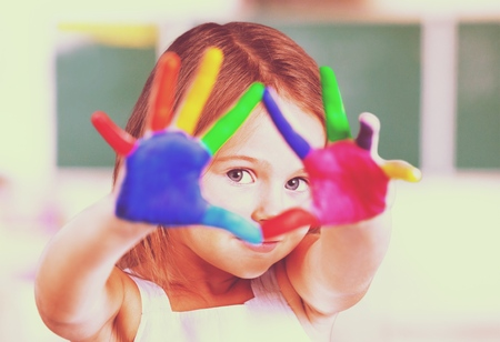 games hand: Painted colorful hands. Stock Photo