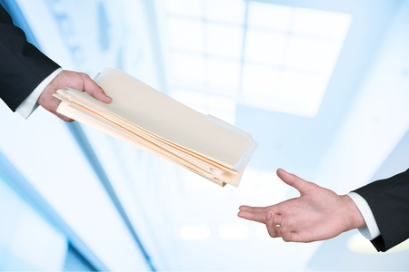 Hand giving documents. Stock Photo