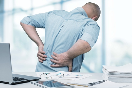 Back pain in office. Stock Photo - 82573708