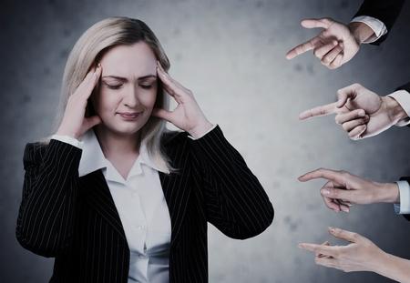 Anxious woman judged. photo