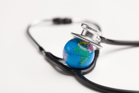 Globe with a stethoscope. 版權商用圖片