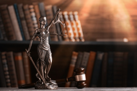 Statue of justice on library background. Stock Photo