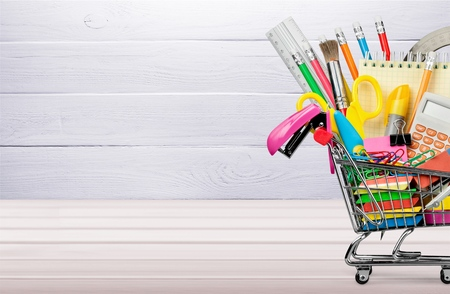 Cart with school supplies on the table.
