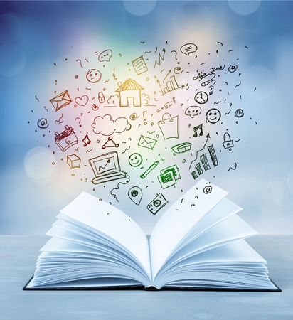education and book concept - close up hand holding open book with magic lights Stock Photo