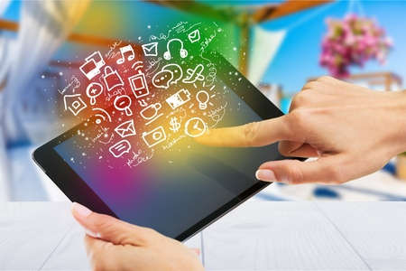 hands holding a tablet with isolated screen Stock Photo