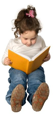 Child reading an orange book photo