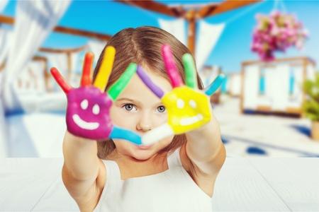 Kids show painted hand. photo