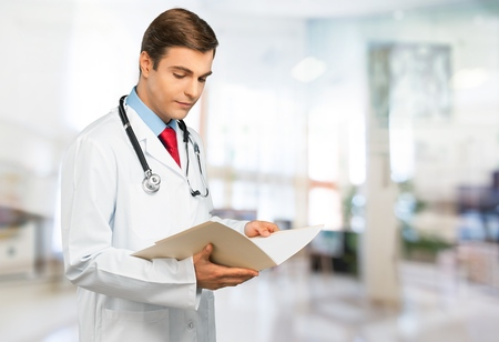 A doctor in medical uniform reading a report. photo