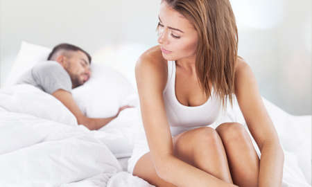 Young couple in bed. Stock Photo