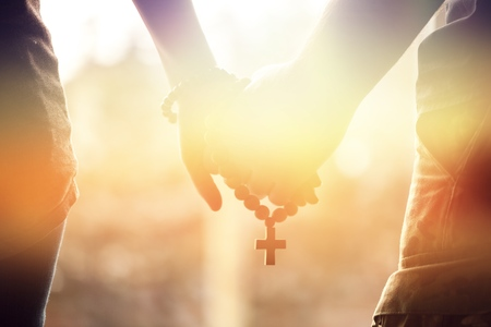 Holding rosary in hand. Stock Photo - 86281622
