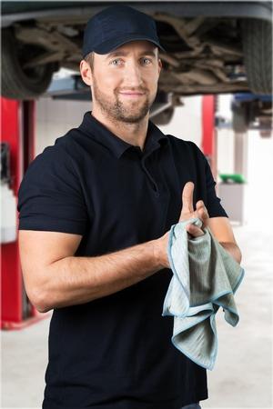 A Little bit of elbow-grease ensures a thorough service. Auto repair shop. Mechanic. Stock Photo