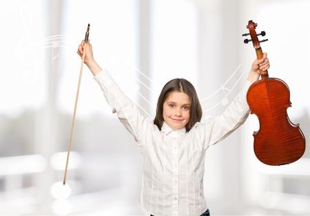 violinista: Child and violin.