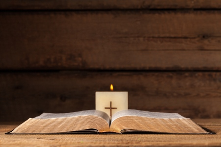 Open bible and candle. Stock fotó