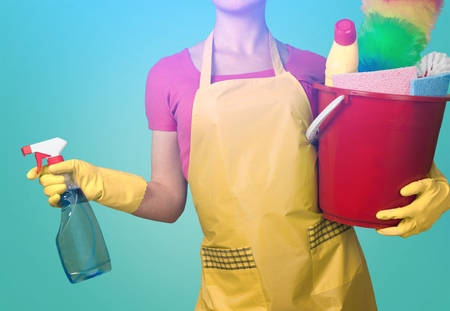 Woman in Apron with Rubber Gloves and Duster
