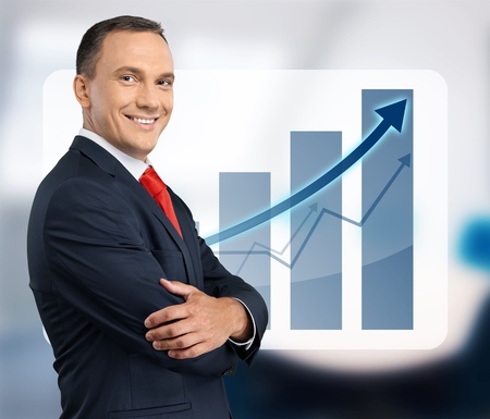 Businessman with trajectory graph