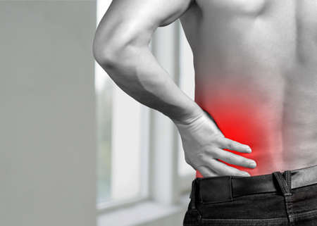 Backache. Pain in the lower back. Mans back Banque d'images
