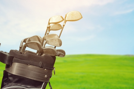 Golf Bag and Clubs Against Grass Banque d'images