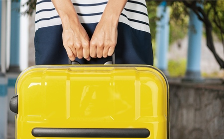 Woman with baggage.
