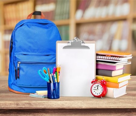 School Backpack with stationery, close-up view