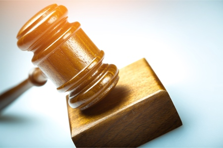 A wooden judge gavel and soundboard on blue  background in perspective