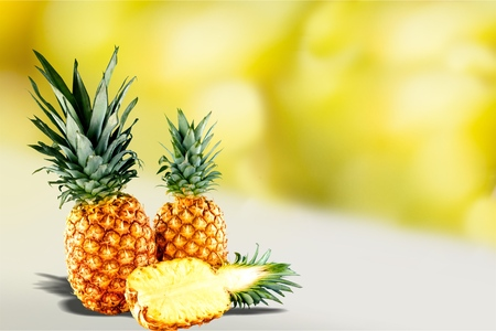 Ripe tropical pineapples on blurred background