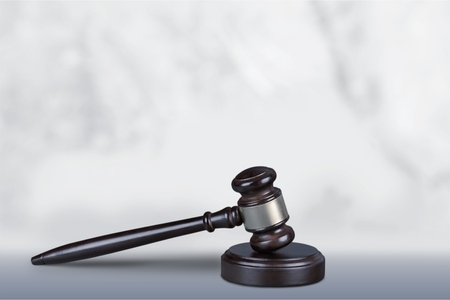 Wooden judge gavel on light background