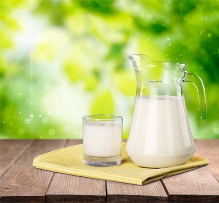 Milk in jar and glass Stock Photo