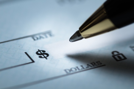 Writing a check 스톡 콘텐츠