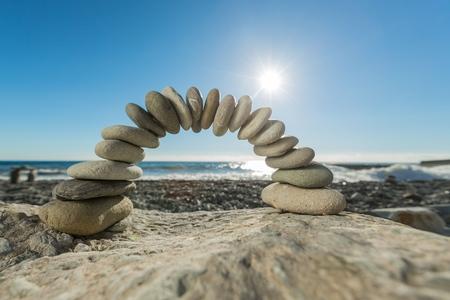 Boog gemaakt van kiezelstenen Stockfoto