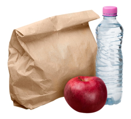 Paper Lunch Bag with Red Apple and Water Bottle - Isolated Stock Photo