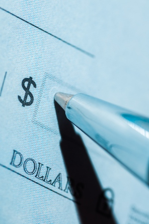 Pen Writing on a Blank Check - Close Up Stock Photo