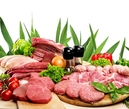 Raw Meat slices on wooden background Stockfoto