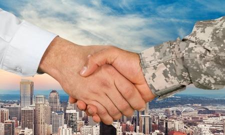 Military and Businessman Handshake