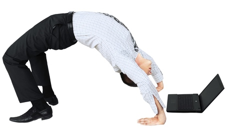 Businessman Doing Yoga and Using Laptop - Isolated 스톡 콘텐츠