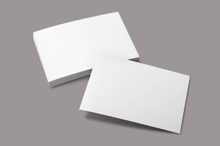Blank portrait A4. brochure magazine isolated on gray, changeable background  white paper isolated on gray 版權商用圖片