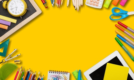 back to school or office styled  scene with multicolored school supplies on yellow , back to school conceptual background Stock Photo