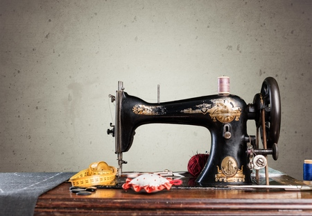 Retro sewing machine with supplies isolated in room