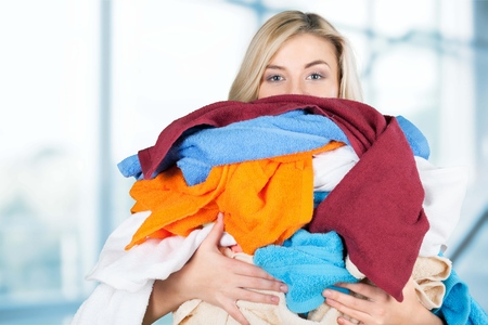 woman carrying clothes Stock Photo