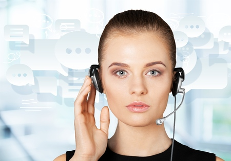 futuristic female helpline operator with headphones and virtual screen Stock Photo
