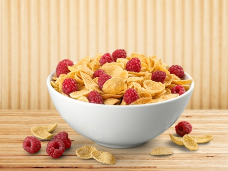 Bowl of cornflakes and raspberries