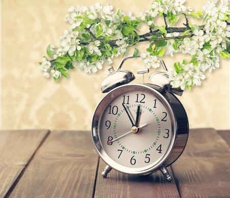 Retro alarm clock on light background