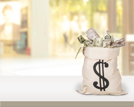 Bag full of money on light background