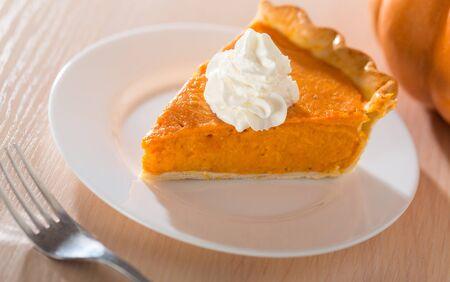 Pumpkin Pie Slice With Fork Stock Photo