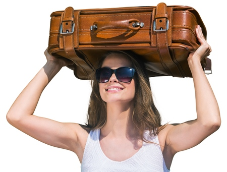 Woman Carrying Suitcase on Her Head Isolated