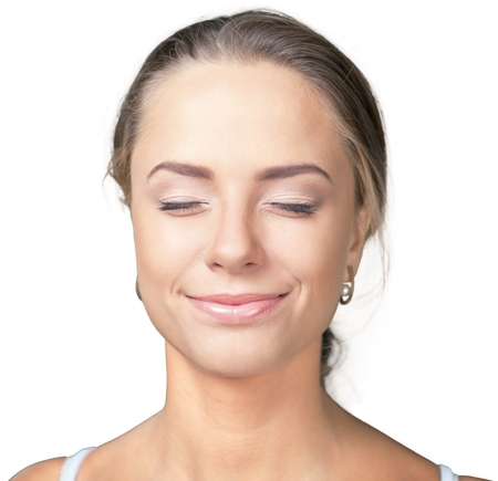 Closeup of a Woman Smiling with Eyes Closed 写真素材