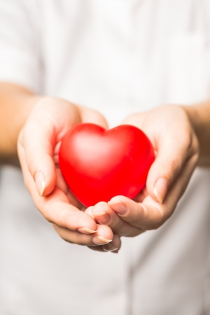Female Doctor Holding a Heart Stock Photo