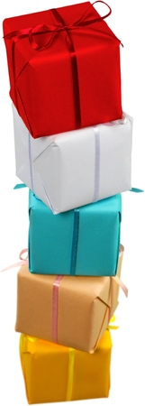 Stack of small boxes wrapped in solid colored wrapping paper with matching ribbon Stock Photo