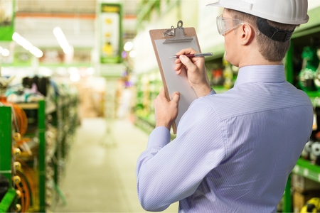 health and safety officer inside factory doing inspection Stockfoto