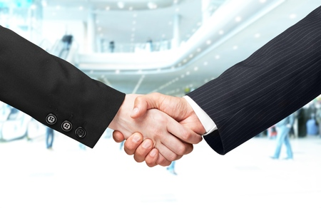 investor businessman handshake together