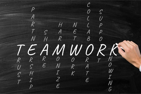 business hand writing teamwork concept crossword Stock Photo
